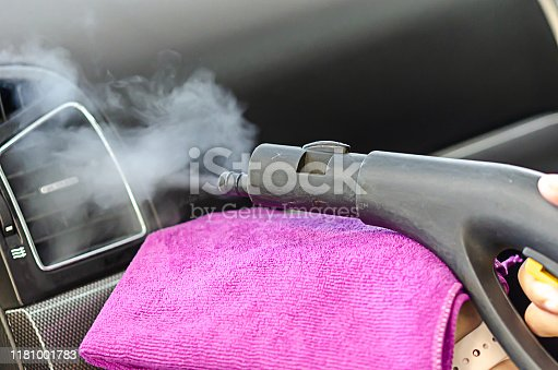 970100874 istock photo Cleaning of car air conditioner 1181001783