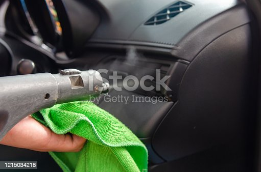 970100874 istock photo Cleaning of car air conditioner 1215034218
