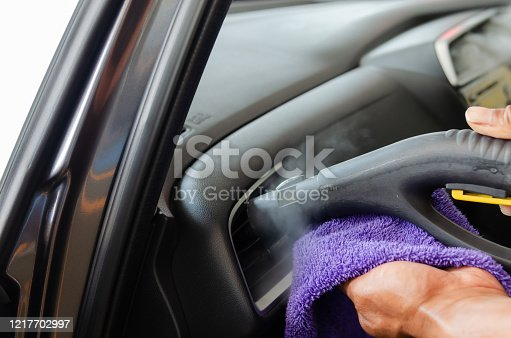 970100874 istock photo Cleaning of car air conditioner 1217702997