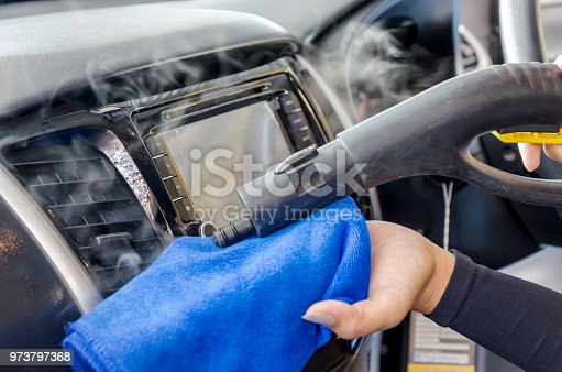 970100874 istock photo Cleaning of car air conditioner 973797368