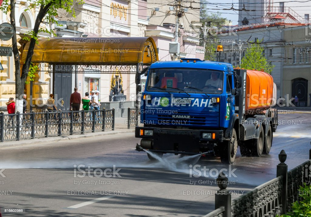Cleaning of city   Lenin streets with a washing machine stock photo