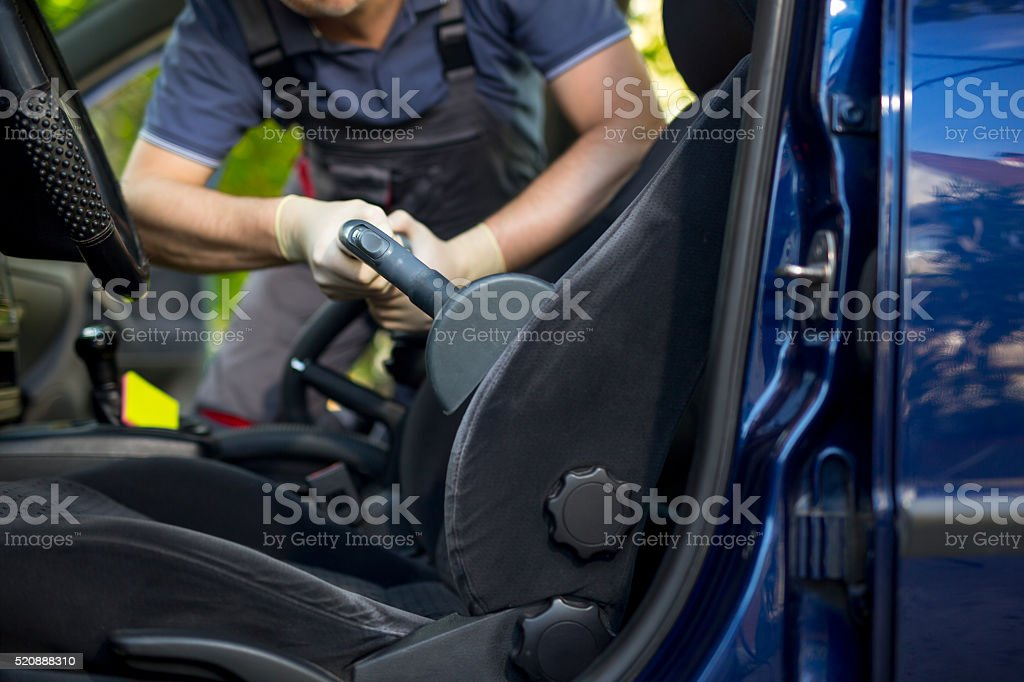 Cleaning of interior of the car with vacuum cleaner stock photo