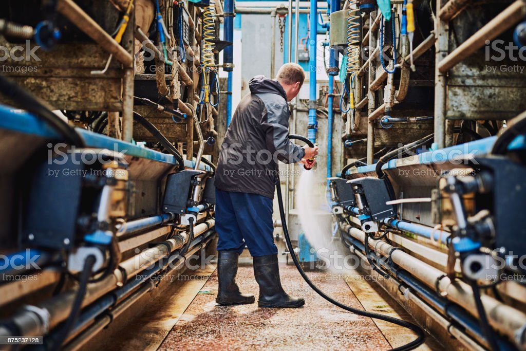 Cleaning off the factory floor - foto stock