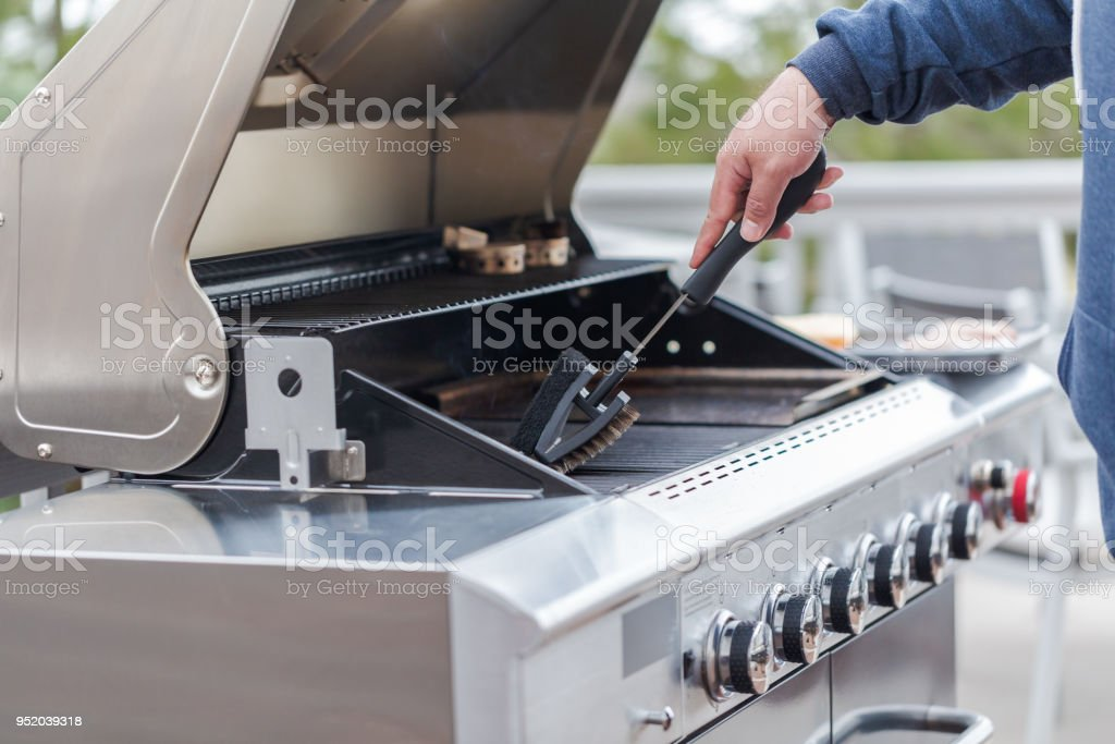 Cleaning outdoor gas grill royalty-free stock photo