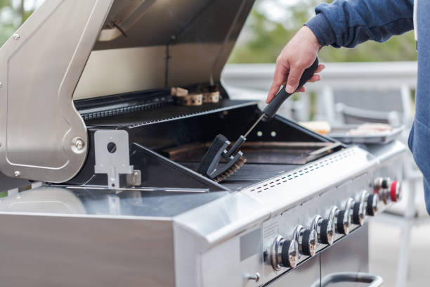 Cleaning outdoor gas grill Cleaning outdoor gas grill before next grilling. barbecue grill stock pictures, royalty-free photos & images