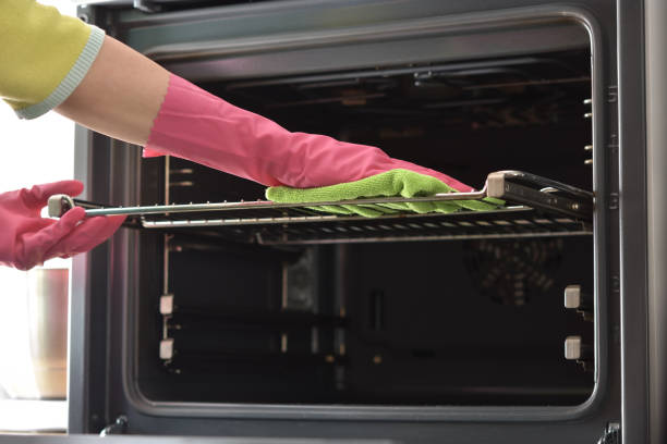 Cleaning oven. Clean oven in kitchen. Cleaning the oven. Woman's hand in household cleaning gloves cleans oven inside. Clean oven in kitchen. oven stock pictures, royalty-free photos & images