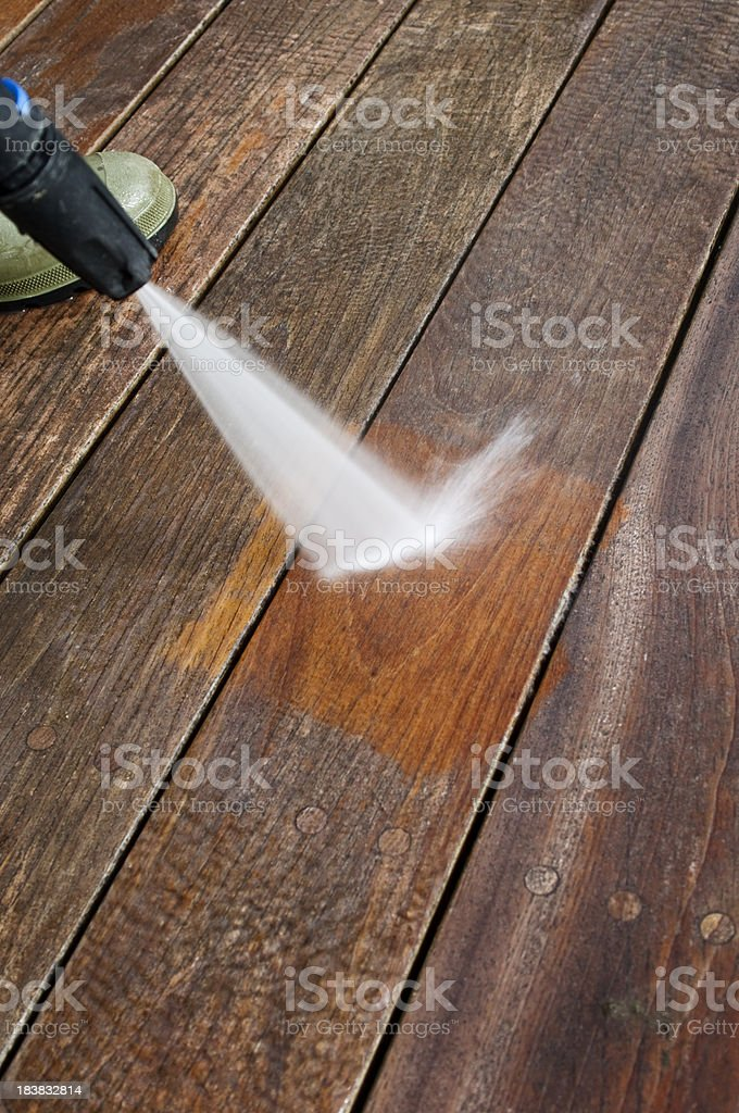 Cleaning Patio Decking With A Pressure Hose stock photo