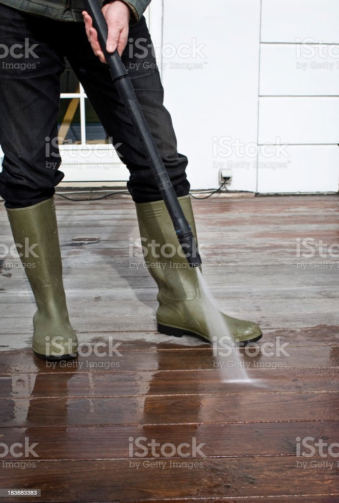 Cleaning Patio Decking With  A Pressure Hose. stock photo