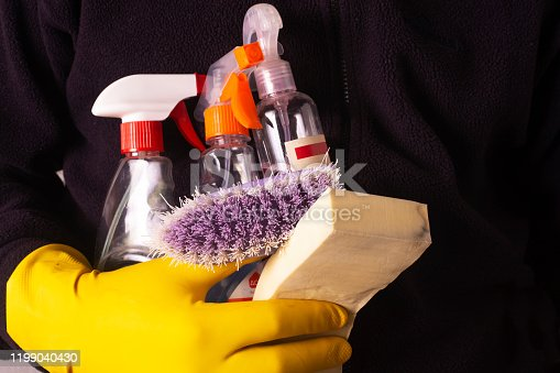 istock Cleaning products for cleaning the bathroom in the hands of a cleaner. 1199040430