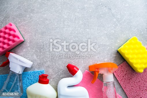 istock Cleaning products on stone background with copyspace. top view 624248762