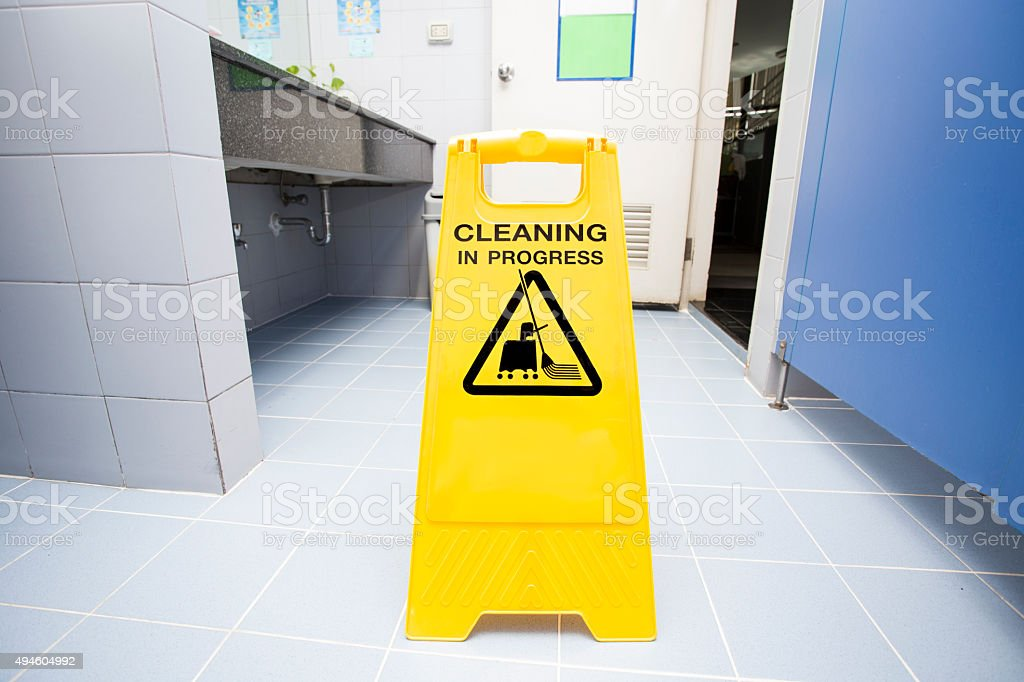 cleaning progress caution sign in toilet stock photo