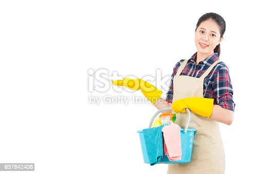 istock cleaning service with presenting gesture 637842408