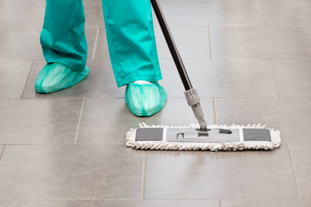 cleaning services with washing mop in sterile operating room stock photo