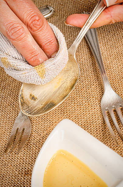 Cleaning silverware stock photo