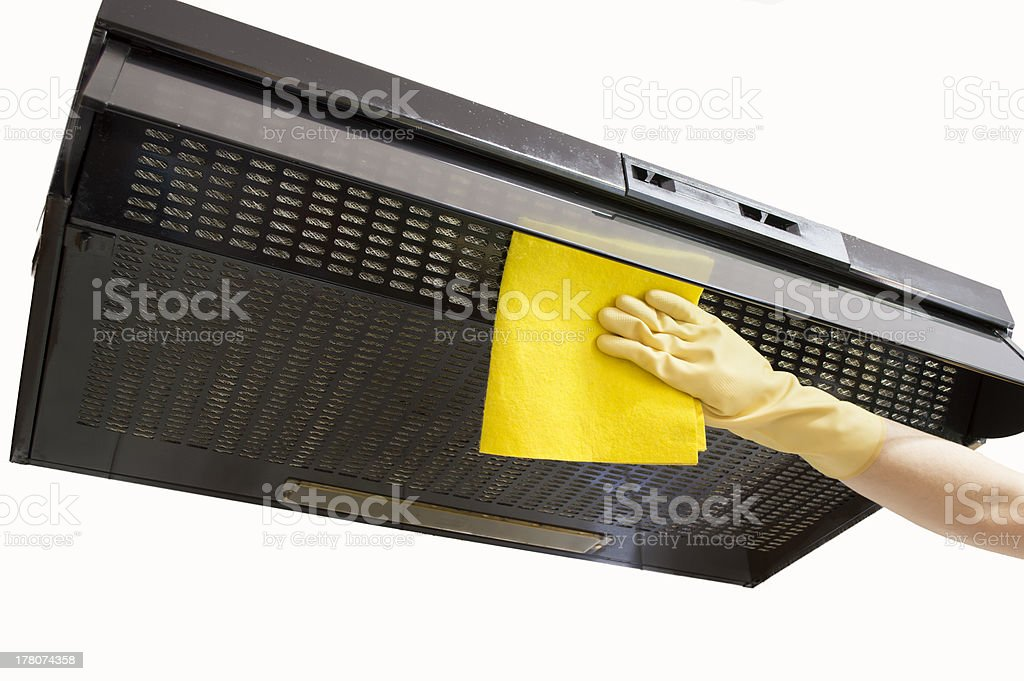 cleaning Smoke exhaust with gloves and cloth stock photo