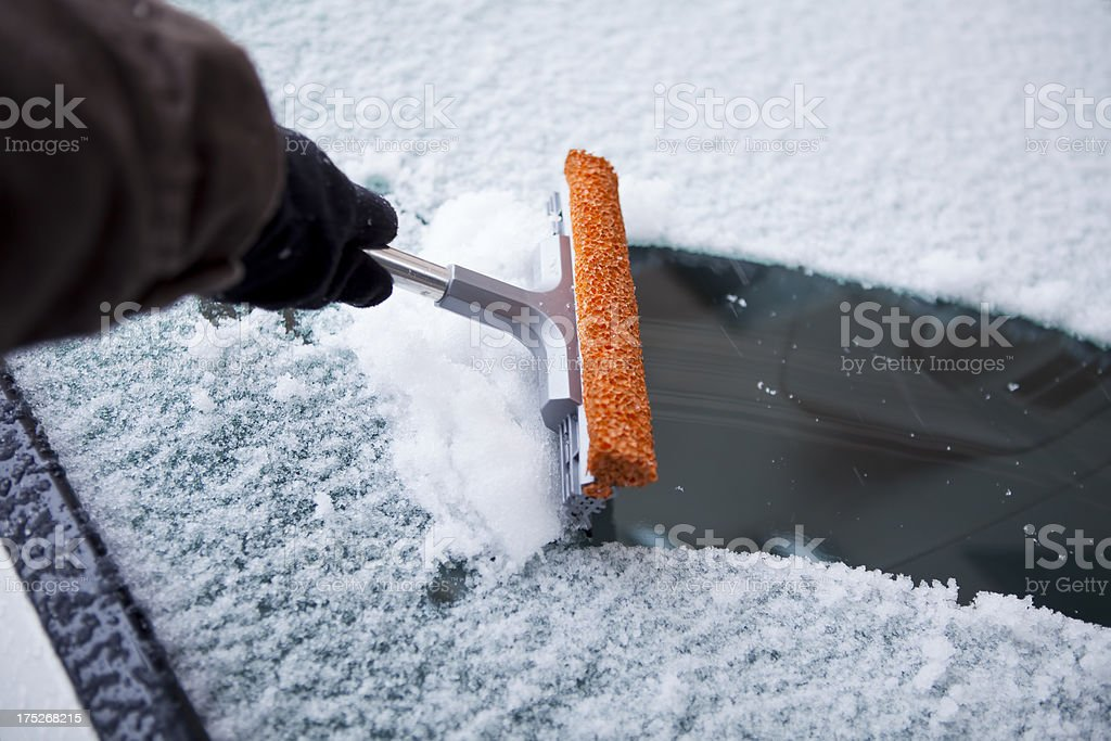 cleaning snow from windshield royalty-free stock photo