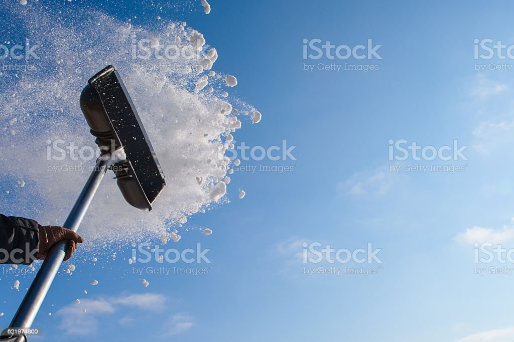 Cleaning snow shovel stock photo