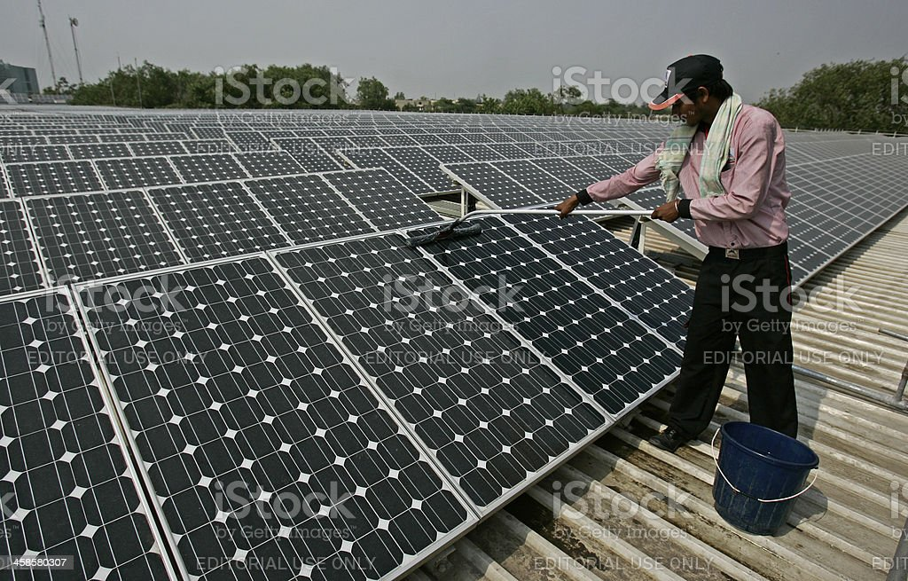 Cleaning Solar panel stock photo