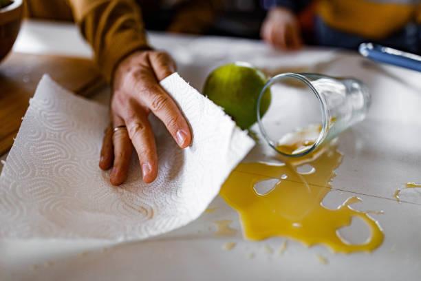 Cleaning spilled orange juice! stock photo