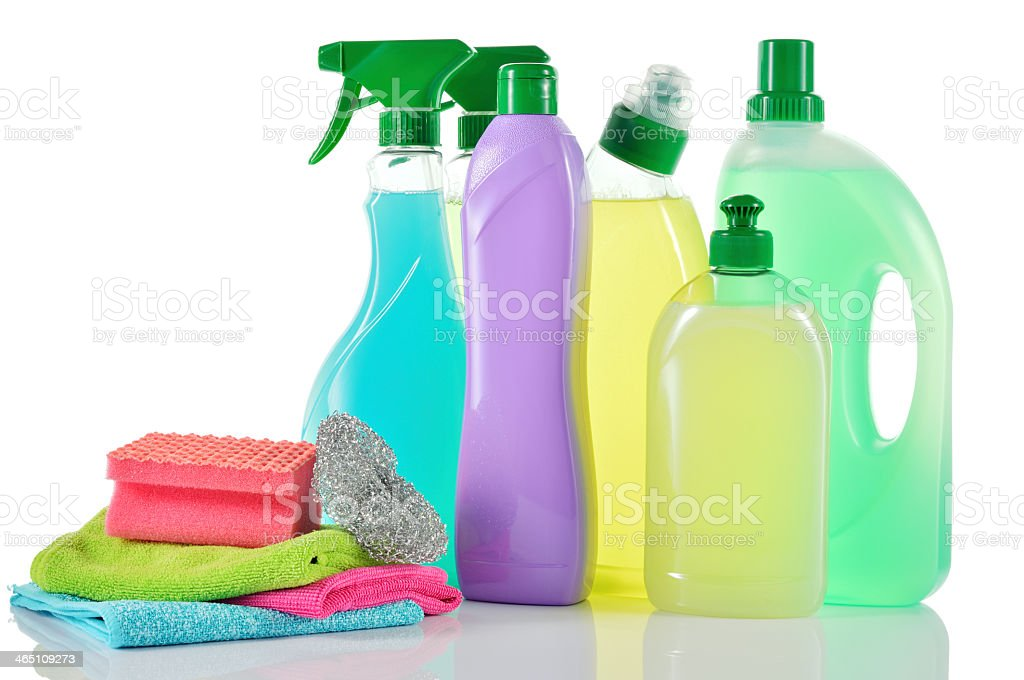Cleaning sprays and bottles with pile of sponges and cloths stock photo