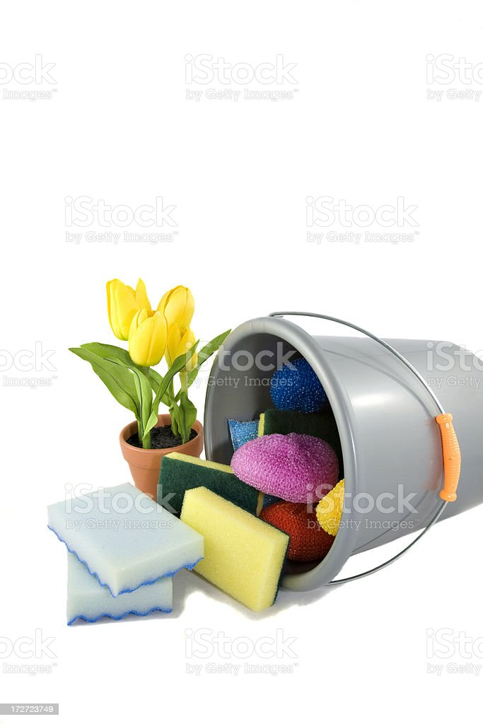 Cleaning supplies dumped out of bucket with flowers beside royalty-free stock photo