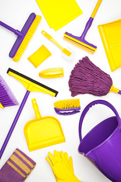 Cleaning Supplies Household Cleaning Supplies Shoot from Above on White Background. Cleaning Concepts. broom stock pictures, royalty-free photos & images