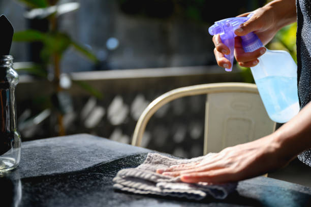 Cleaning table amid Covid-19 pandemic era stock photo