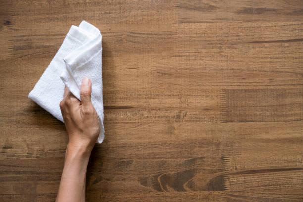 cleaning table by woman hand - strofinare toccare foto e immagini stock