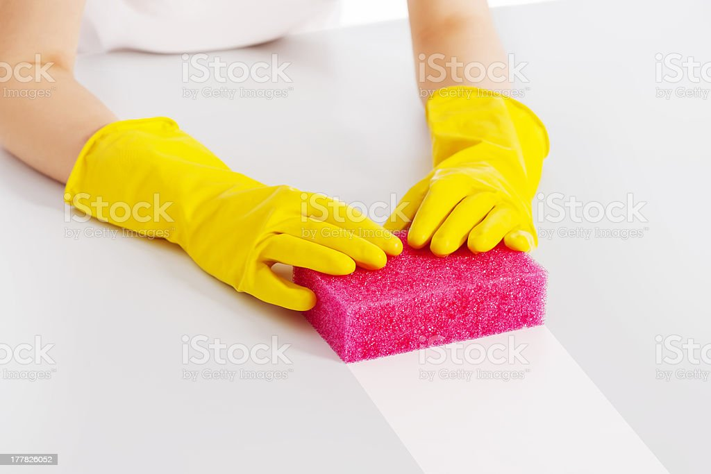 Cleaning table with pink sponge and protective glove royalty-free stock photo
