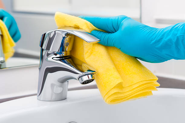 Cleaning Tap Woman doing chores in bathroom, cleaning tap cleaning equipment stock pictures, royalty-free photos & images