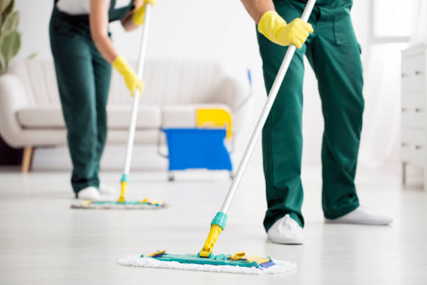 Cleaning team wiping the floor Cleaning team wiping the floor using mops in the flat cleaner stock pictures, royalty-free photos & images