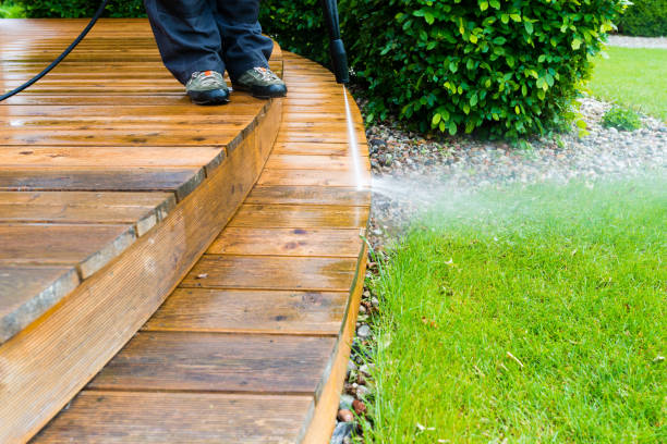 cleaning terrace with a power washer - high water pressure cleaner on wooden terrace surface stock photo