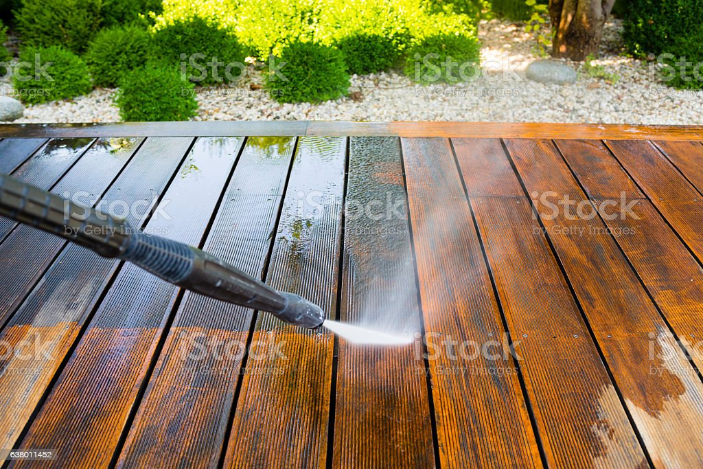 cleaning terrace with a pressure washer stock photo
