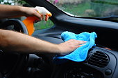 istock Cleaning the car inside - Men hands clean the car 1003153916