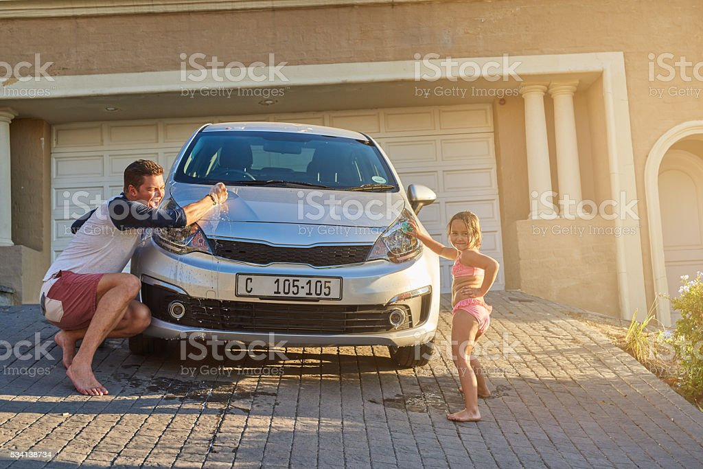 Cleaning the car together stock photo