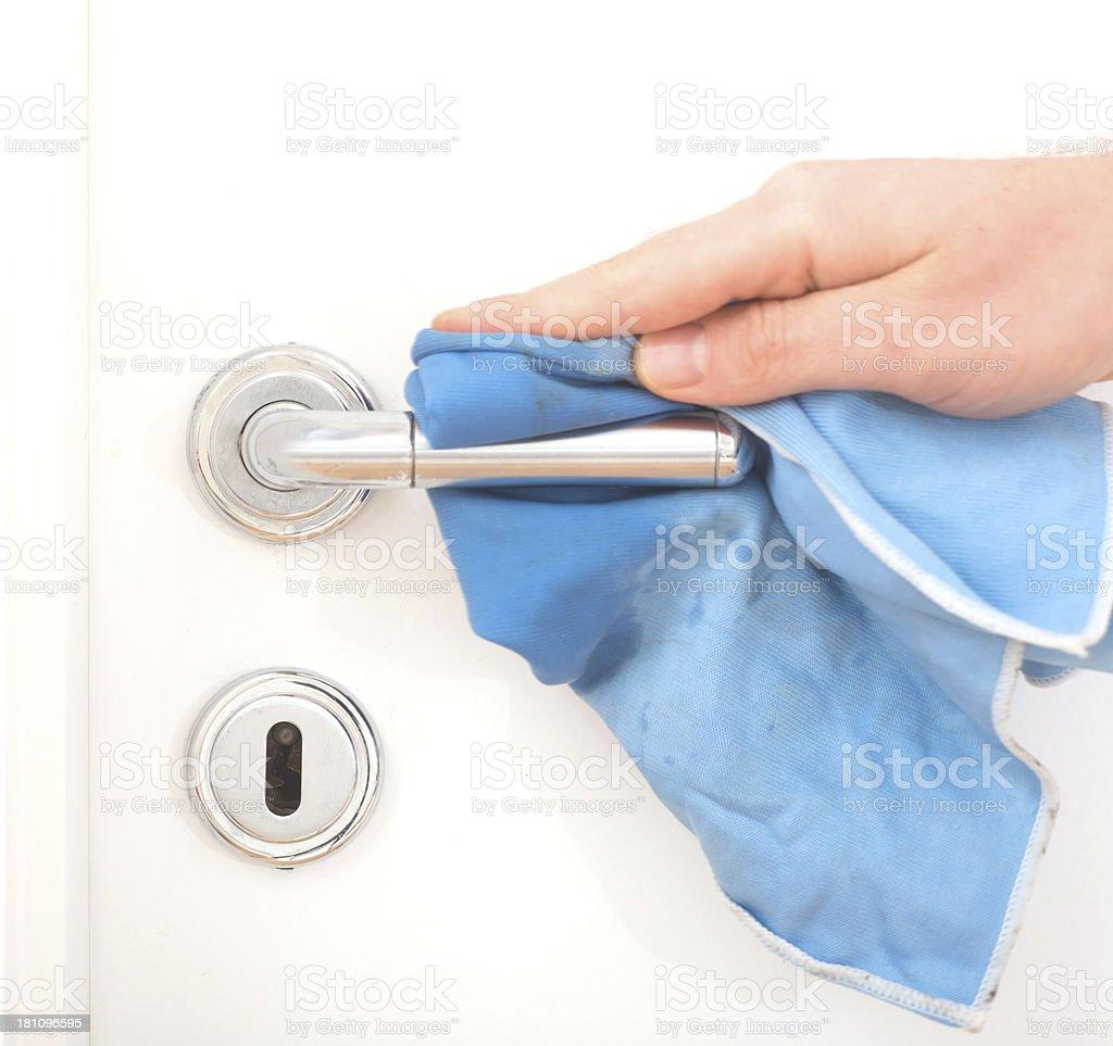 cleaning the doorknob - Klinkenputzen stock photo