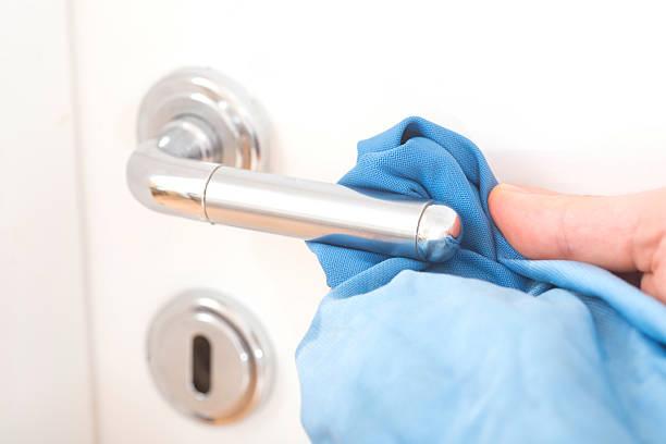 cleaning the doorknob cleaning the doorknob. German saying: