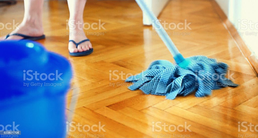 Cleaning the floor with a mop. stock photo