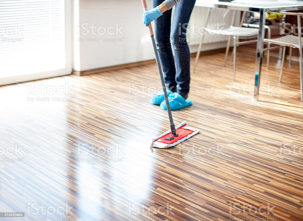 Cleaning the kitchen floor stock photo