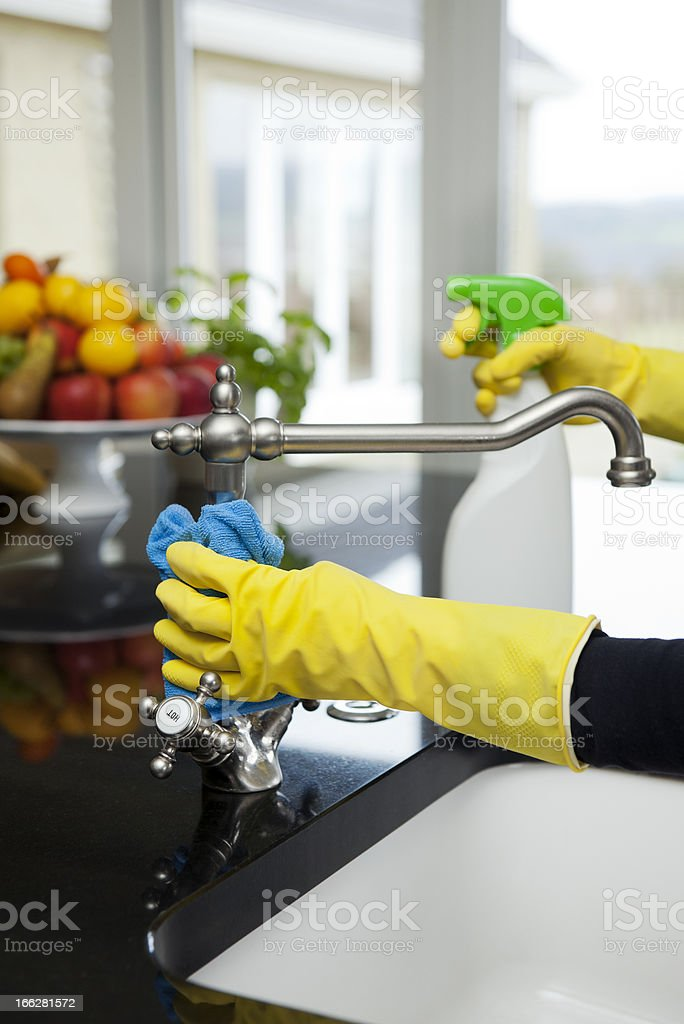 Cleaning the kitchen sink royalty-free stock photo