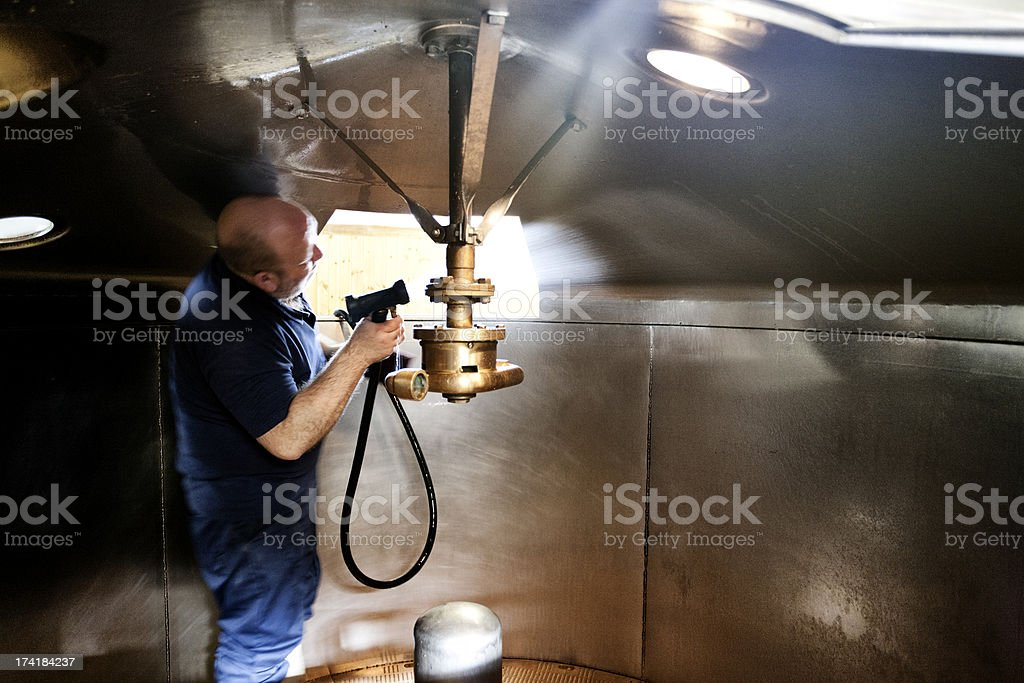 Cleaning the mash tun and dissolving vat stock photo