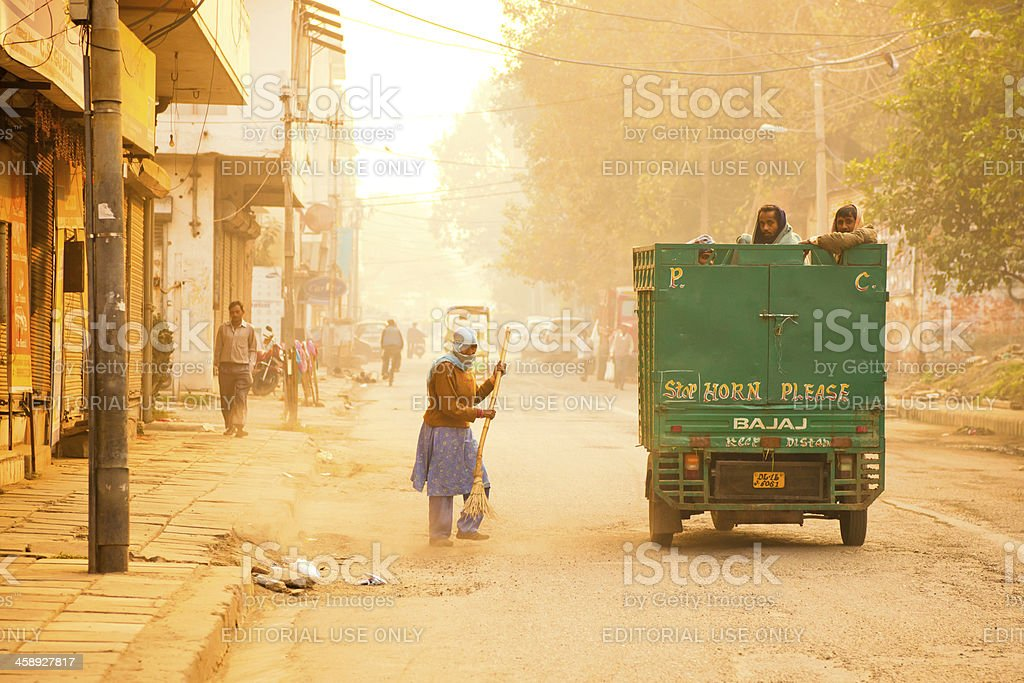 cleaning the road in India stock photo