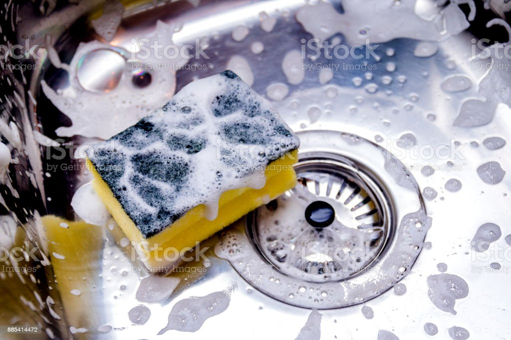 cleaning the sink in kitchen stock photo
