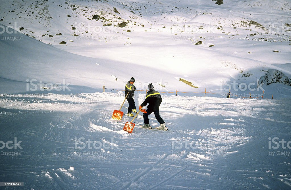 Cleaning the ski slope royalty-free stock photo