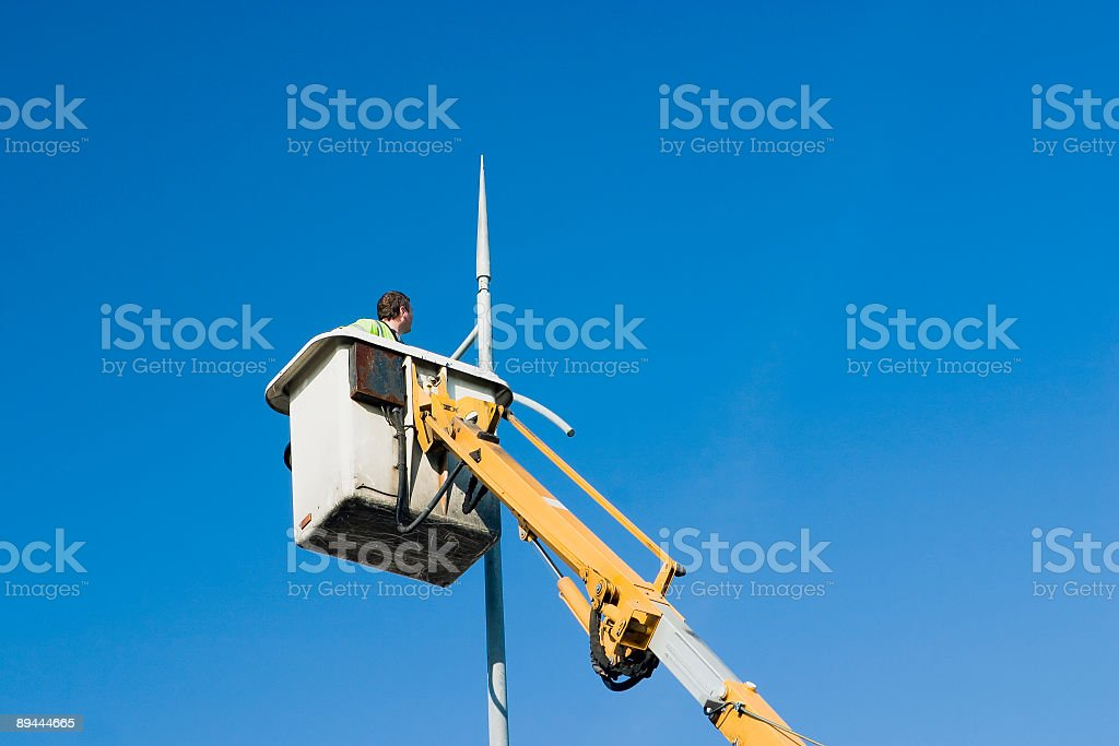 cleaning the street lights royalty-free stock photo