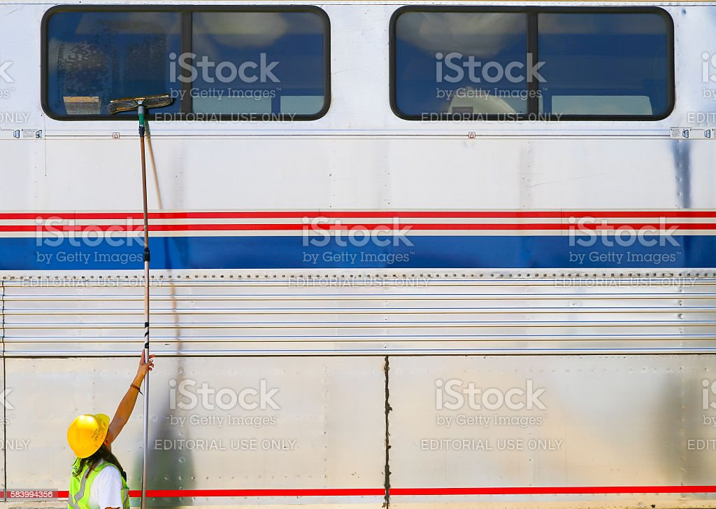 Cleaning the Train Windows stock photo