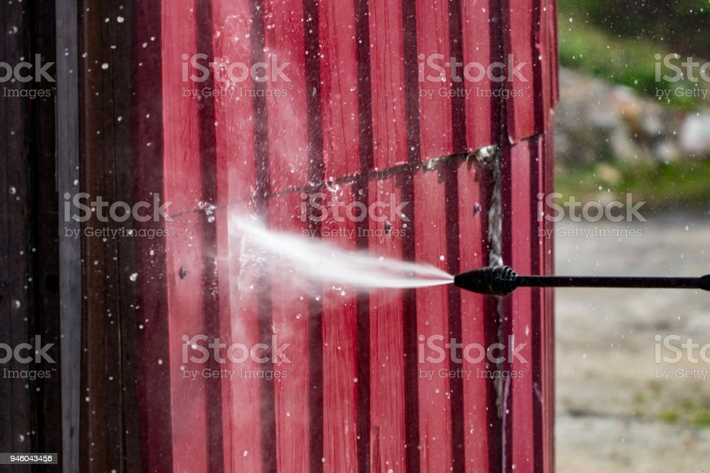 cleaning the wall high pressure cleaner, close up stock photo