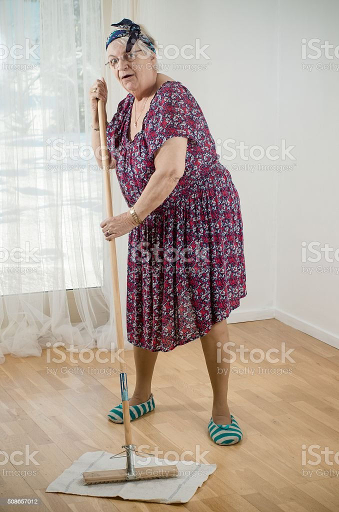 Cleaning the wooden floor stock photo