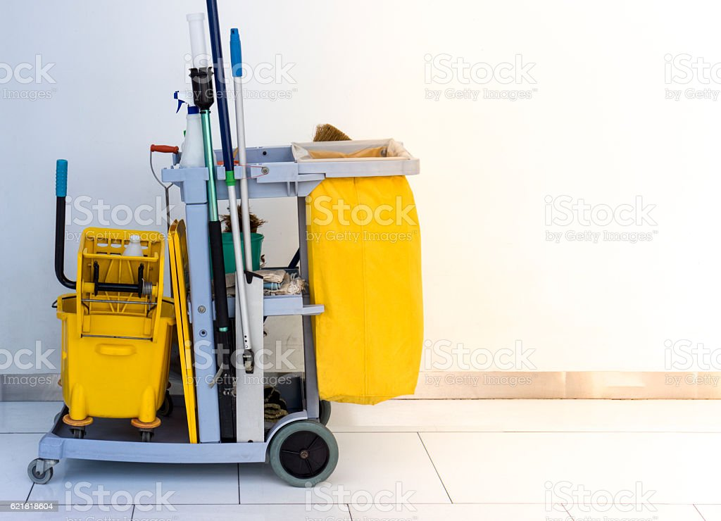 Cleaning tools on cart stock photo