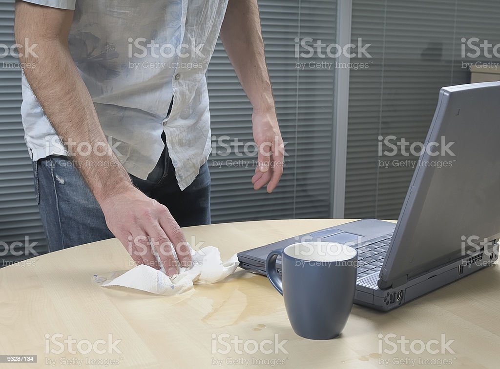 Cleaning Up Spillage Next To A Laptop royalty-free stock photo